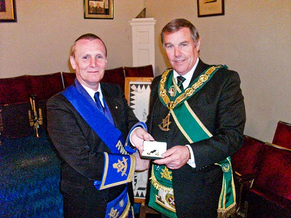 Ramsay McGhee is presented with Gold Masonic Cufflinks in honour of his five years as RWPGM